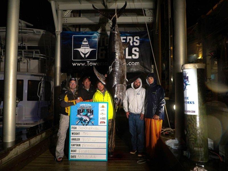 group-of-fisherman-on-dock-with-swordfish.jpg