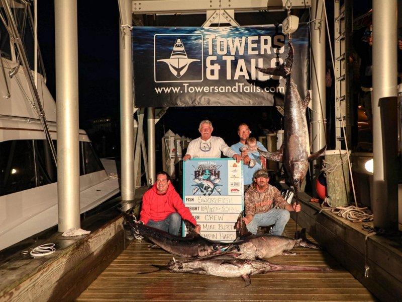 group-of-men-with-swordfish-on-dock.jpg