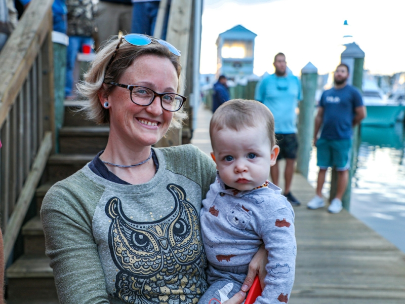 lady-standing-on-dock-with-child.jpg
