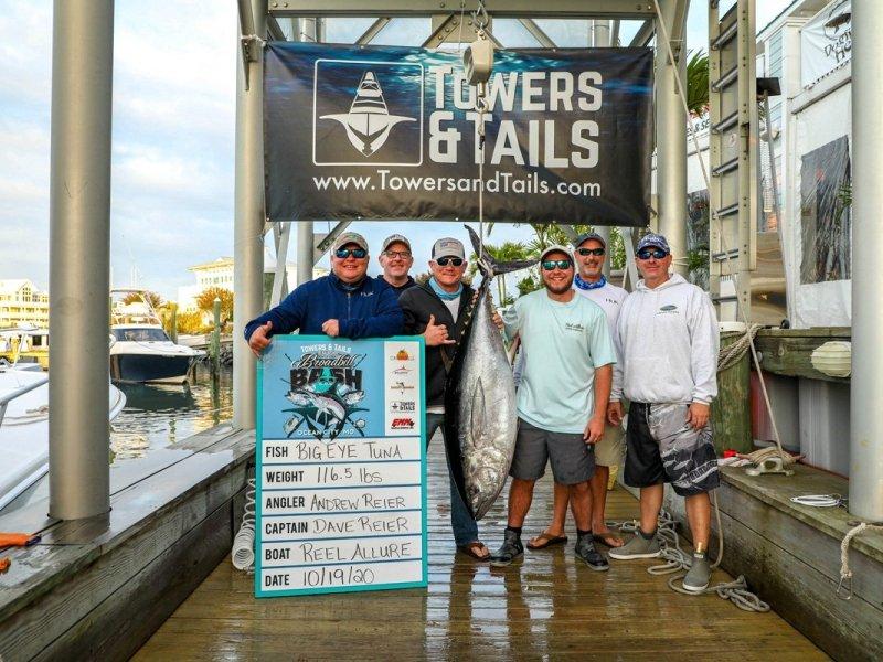 men-standing-with-tuna-at-marina.jpg